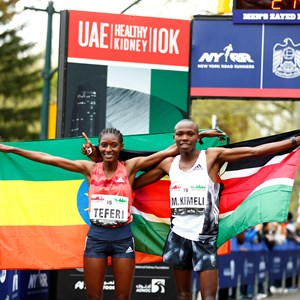 First place finishers Mathew Kimeli and Senbere Teferi pose with their nation's flags.